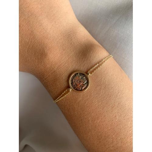Złota bransoletka moneta